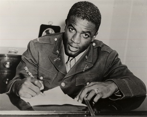 Jackie Robinson signing his contract with the Brooklyn Dodgers {Source: Google Images}