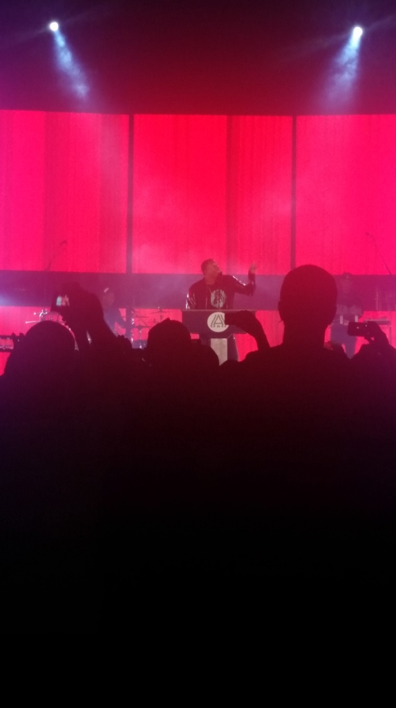Lecrae performing 'Welcome to America""